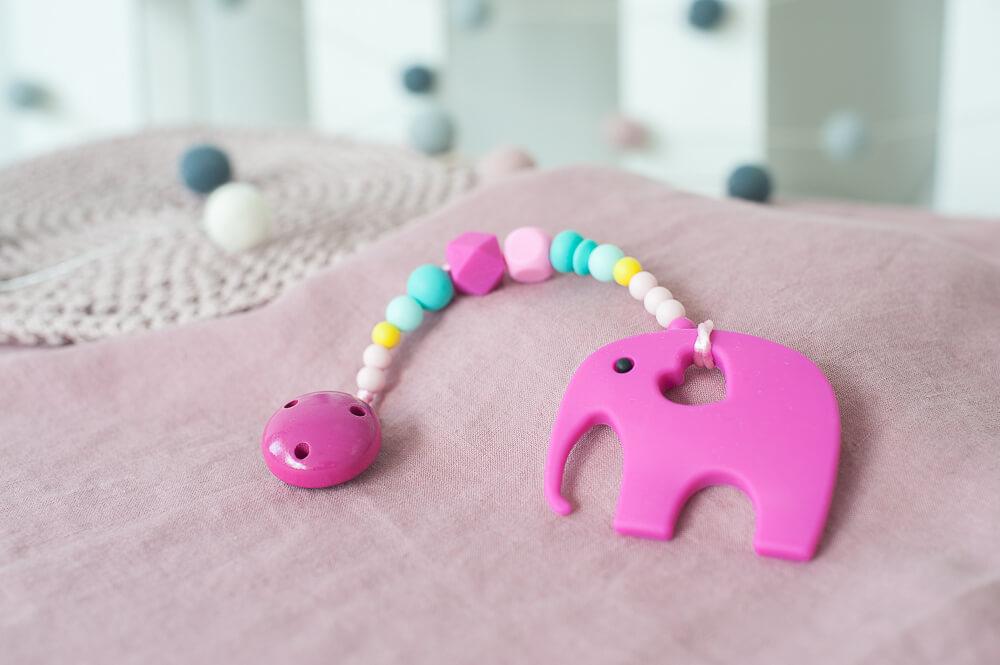 Silikoninis ryškus rožinis kramtukas drambliukas mergaitei su čiulptuko laikikliu