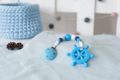 Žydras silikoninis kramtukas vairas su prisegamu čiulptuko laikikliu berniukui