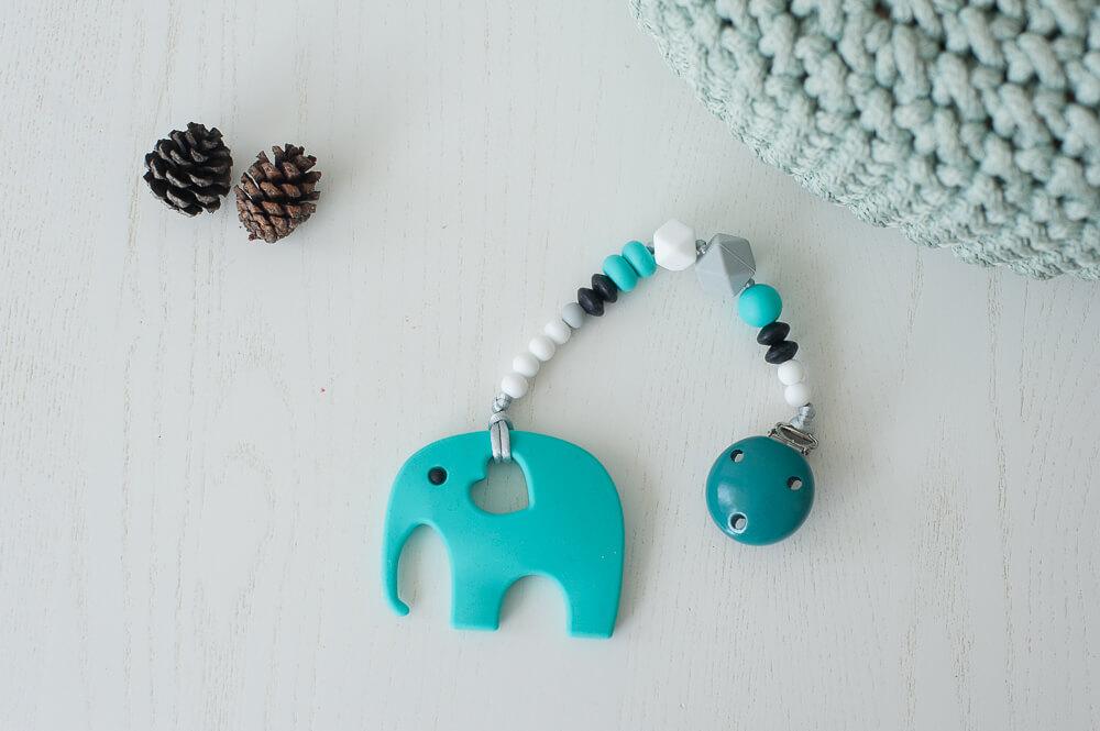 Silikoninis kramtukas drambliukas ir čiulptuko laikiklis kūdikiui